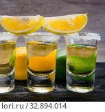 Купить «Tequila drink served in glasses with lime and salt», фото № 32894014, снято 18 сентября 2017 г. (c) Elnur / Фотобанк Лори