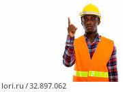Купить «Studio shot of young black African man construction worker pointing finger up», фото № 32897062, снято 23 февраля 2020 г. (c) easy Fotostock / Фотобанк Лори