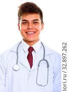 Купить «Studio shot of young happy man doctor smiling isolated against white background», фото № 32897262, снято 23 февраля 2020 г. (c) easy Fotostock / Фотобанк Лори