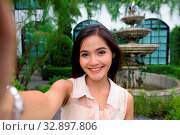 Купить «Portrait of young beautiful Asian woman taking selfie while relaxing at the coffee shop», фото № 32897806, снято 27 мая 2020 г. (c) easy Fotostock / Фотобанк Лори