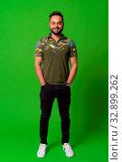 Купить «Studio shot of young bearded Indian man against chroma key with green background», фото № 32899262, снято 23 февраля 2020 г. (c) easy Fotostock / Фотобанк Лори