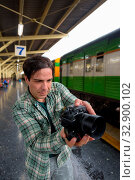 Купить «Portrait of handsome Persian tourist man at the railway station in Bangkok, Thailand», фото № 32900102, снято 7 июля 2020 г. (c) easy Fotostock / Фотобанк Лори
