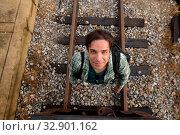Купить «Portrait of handsome Persian tourist man at the railway station in Bangkok, Thailand», фото № 32901162, снято 7 июля 2020 г. (c) easy Fotostock / Фотобанк Лори