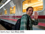 Купить «Portrait of handsome Persian tourist man at the railway station in Bangkok, Thailand», фото № 32902086, снято 7 июля 2020 г. (c) easy Fotostock / Фотобанк Лори