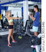 Купить «Couple during weightlifting workout», фото № 32903646, снято 16 июля 2018 г. (c) Яков Филимонов / Фотобанк Лори