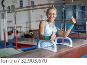 Купить «Woman posing near gymnastic equipment», фото № 32903670, снято 18 июля 2018 г. (c) Яков Филимонов / Фотобанк Лори