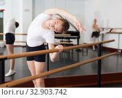 Купить «Young efficient dancer exercising in ballroom», фото № 32903742, снято 26 апреля 2019 г. (c) Яков Филимонов / Фотобанк Лори