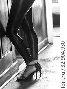 Купить «Silhouette of a woman's legs wearing black leggings and high heels.», фото № 32904930, снято 23 октября 2019 г. (c) age Fotostock / Фотобанк Лори
