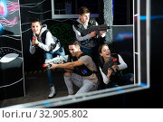 Friends having fun on lasertag arena. Стоковое фото, фотограф Яков Филимонов / Фотобанк Лори