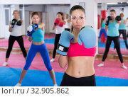 Купить «Portrait of sportswoman is training box exercises», фото № 32905862, снято 8 октября 2017 г. (c) Яков Филимонов / Фотобанк Лори