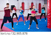 group of females and their trainer are boxing in gym. Стоковое фото, фотограф Яков Филимонов / Фотобанк Лори