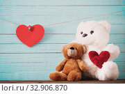 Купить «Teddy bear with red heart on old wooden background. Valentine's day concept», фото № 32906870, снято 14 декабря 2019 г. (c) Майя Крученкова / Фотобанк Лори
