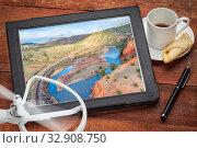 Upper Colorado River below McCoy, Colorado - rewieining and editing aerial image on a digital tablet. Стоковое фото, фотограф Zoonar.com/Marek Uliasz / easy Fotostock / Фотобанк Лори