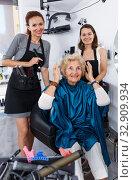 Hairstylists presenting result of styling to female client. Стоковое фото, фотограф Яков Филимонов / Фотобанк Лори