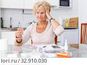 Купить «Confused woman among a lot of medicines», фото № 32910030, снято 11 июля 2018 г. (c) Яков Филимонов / Фотобанк Лори