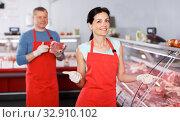 Positive adult female and man demonstrating meat. Стоковое фото, фотограф Яков Филимонов / Фотобанк Лори