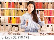 Купить «Female customer choosing hair dye», фото № 32910178, снято 24 октября 2019 г. (c) Яков Филимонов / Фотобанк Лори