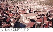 Купить «Aerial view of tiled roofs and old streets of Daroca, Spain», видеоролик № 32914110, снято 10 марта 2019 г. (c) Яков Филимонов / Фотобанк Лори