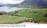Купить «Panoramic view over Embalse de Zahara inland lake, Andalusia, Spain», видеоролик № 32914114, снято 18 апреля 2019 г. (c) Яков Филимонов / Фотобанк Лори