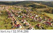 Купить «Autumnal aerial landscape of czech village Ostrov u Macochy in autumn day», видеоролик № 32914286, снято 16 октября 2019 г. (c) Яков Филимонов / Фотобанк Лори
