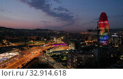 Купить «Aerial view of illuminated multicolored Torre Agbar with night cityscape on background», видеоролик № 32914618, снято 28 июня 2019 г. (c) Яков Филимонов / Фотобанк Лори