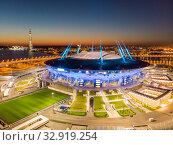 Saint Petersburg, Russia - August 29, 2019: Night Aerial panoramic view of Zenit Arena with illumination. New football Stadium for the FIFA Soccer World Cup 2018. photo from quadrocopter drone flight. Редакционное фото, фотограф Алексей Ширманов / Фотобанк Лори