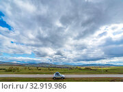 Russia, Bashkortostan, September 2019: Ural. Picturesque panorama from the road to the village and mountains on the horizon. Rest motorists at the edge of the road. Редакционное фото, фотограф Акиньшин Владимир / Фотобанк Лори