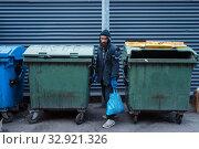 Купить «Bearded bum searching food in trashcan on street», фото № 32921326, снято 26 октября 2019 г. (c) Tryapitsyn Sergiy / Фотобанк Лори
