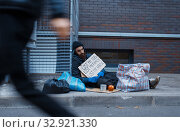 Beggar lost all in his life, poor on city street. Стоковое фото, фотограф Tryapitsyn Sergiy / Фотобанк Лори