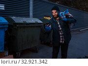 Купить «Happy beggar found mobile phone in trashcan», фото № 32921342, снято 26 октября 2019 г. (c) Tryapitsyn Sergiy / Фотобанк Лори