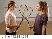 Купить «Players with squash rackets stands face to face», фото № 32921354, снято 12 ноября 2019 г. (c) Tryapitsyn Sergiy / Фотобанк Лори
