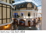 "Купить «Russia, Blagoveshchensk, July 2019: Interior in the style of the old city with cafes and eateries in the shopping center ""Islands"" in the city of Blagoveshchensk», фото № 32921454, снято 4 июля 2019 г. (c) Катерина Белякина / Фотобанк Лори"