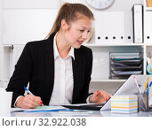 Купить «Office woman worker is working with documents and laptop», фото № 32922038, снято 6 апреля 2020 г. (c) Яков Филимонов / Фотобанк Лори