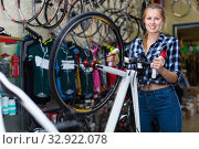 Portrait of girl who is standing with bicycle in store. Стоковое фото, фотограф Яков Филимонов / Фотобанк Лори