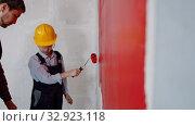 Купить «Apartment renovation - a little boy painting wall in red», видеоролик № 32923118, снято 3 июня 2020 г. (c) Константин Шишкин / Фотобанк Лори
