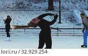 Купить «A young blonde woman figure skater spinning around herself on ice rink outdoors», видеоролик № 32929254, снято 29 марта 2020 г. (c) Константин Шишкин / Фотобанк Лори