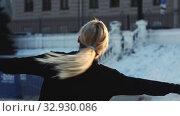 Купить «A young woman professional figure skater spinning around herself on ice rink outdoors», видеоролик № 32930086, снято 29 марта 2020 г. (c) Константин Шишкин / Фотобанк Лори