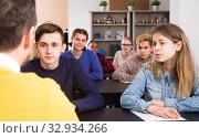 Купить «serious male and female students following explanations of teacher», фото № 32934266, снято 28 февраля 2017 г. (c) Яков Филимонов / Фотобанк Лори