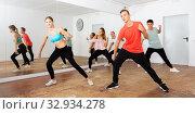 Teenagers exercising with coach in choreography class. Стоковое фото, фотограф Яков Филимонов / Фотобанк Лори