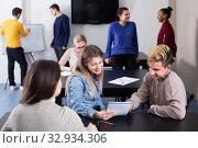 vigorous classmates having animated talks at break between classes. Стоковое фото, фотограф Яков Филимонов / Фотобанк Лори
