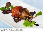 Купить «Wrapped in bacon baked quail», фото № 32934386, снято 26 января 2020 г. (c) Яков Филимонов / Фотобанк Лори