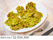 Купить «Fried zucchini fritters», фото № 32934394, снято 20 января 2020 г. (c) Яков Филимонов / Фотобанк Лори