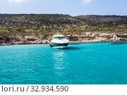 Купить «Blue lagoon of Mediterranean sea with luxury speedboat on water surface. Cyprus island with beautiful coastline», фото № 32934590, снято 22 сентября 2013 г. (c) Кекяляйнен Андрей / Фотобанк Лори