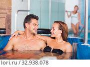 Купить «Romantic couple is talking while relaxing together», фото № 32938078, снято 18 июля 2017 г. (c) Яков Филимонов / Фотобанк Лори
