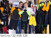 couple standing with flippers and costumes for diving. Стоковое фото, фотограф Яков Филимонов / Фотобанк Лори