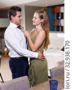 Купить «Loving couple in apartment», фото № 32938170, снято 24 сентября 2018 г. (c) Яков Филимонов / Фотобанк Лори