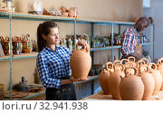 Two positive smiling potters in the process of work at the workshop. Стоковое фото, фотограф Яков Филимонов / Фотобанк Лори