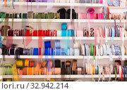 Купить «Colored ribbons on needlework store shelves», фото № 32942214, снято 18 октября 2019 г. (c) Яков Филимонов / Фотобанк Лори