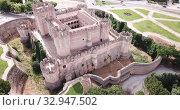 Купить «Picturesque summer landscape with medieval Coca Castle located on outskirts of Spanish town of Coca, Segovia», видеоролик № 32947502, снято 20 июня 2019 г. (c) Яков Филимонов / Фотобанк Лори