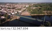 Купить «Aerial view of summer cityscape of small French town of Marmande overlooking Gothic building of Our Lady Church», видеоролик № 32947694, снято 18 июля 2019 г. (c) Яков Филимонов / Фотобанк Лори